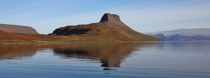 Hestfjoerdur, fjord in the north of Iceland. Mountain reflecting Stock Images