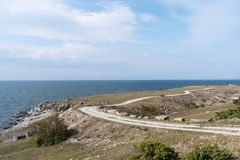 Landscape witha gravel road along the coast Royalty Free Stock Images
