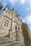 Coastal location around st michaels mount in cornwall england uk. Lookout post in Marizion harbour. White castlated building next royalty free stock photos