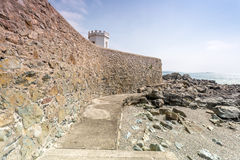 Coastal location around st michaels mount in cornwall england uk. Lookout post in Marizion harbour. White castlated building next stock images