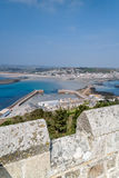 Coastal location around st michaels mount in cornwall england uk. Lookout post in Marizion harbour. White castlated  building next Stock Image