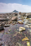 Coastal location around st michaels mount in cornwall england uk. Lookout post in Marizion harbour. White castlated  building next. Stunning coastal location of Stock Photos