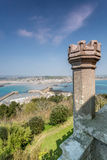 Coastal location around st michaels mount in cornwall england uk. Lookout post in Marizion harbour. White castlated  building next. Stunning coastal location of Stock Image