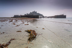 Coastal location around st michaels mount in cornwall england uk. Lookout post in Marizion harbour. White castlated  building next Royalty Free Stock Images