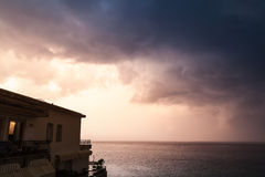 Coastal morning landscape, cloudy sky and house Royalty Free Stock Image