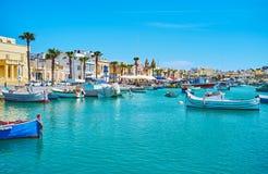 The coastal neighborhood of Marsaxlokk village. That is the popular tourist landmark and joyful place of Malta royalty free stock images