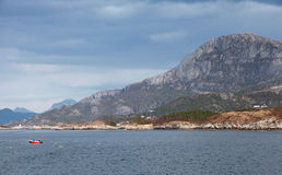 Coastal Norwegian landscape with Mountains, sea and sky Stock Images