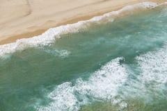Coastal ocean beach from above stock photography