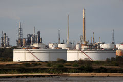A coastal oil refinery. With storage tanks and chimneys Royalty Free Stock Photo