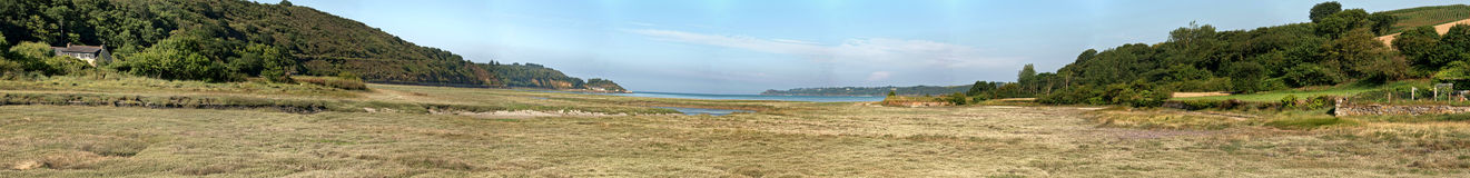 Coastal panoramic grass landscape with blue sky. Brittany. Stock Images