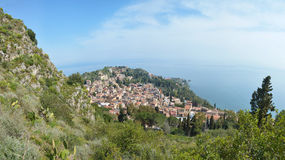 Coastal panoramic landscape, Sicily, Italy. The Taormina city on the Mediterranean coast in Italy Stock Photos