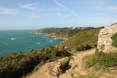 Coastal Path above Moulin Huet Bay, Guernsey. Marker on scenic coastal path above Moulin Huet Bay, Guernsey Stock Images