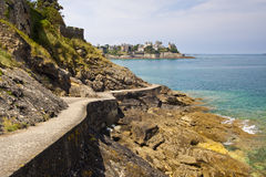 Coastal Path at Dinard. The coastal path at Dinard in France with the grand mansions in the background Royalty Free Stock Photo