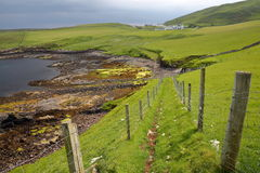 A coastal path leading to the colorful beach of Duntulm Bay in the northern part of the Trotternish peninsula, Isle of Skye, Highl Royalty Free Stock Photography