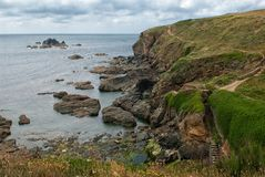 Coastal Path at Lizard Point, Lizard Cornwall UK. The Lizard (Cornish: An Lysardh) is a peninsula in southern Cornwall, England, United Kingdom. The most Stock Images