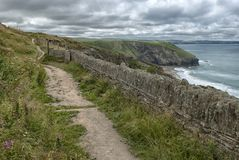 Coastal Path on the North Coast of Cornwall. A stone fence following the coastal path on the North Coast of Cornwall in between Trebarwith Strand and Tintagel stock photography