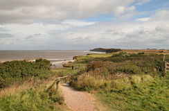 A Coastal Path in Somerset England. A Coastal Path in Somerset, England with people passing the time of day Stock Photography