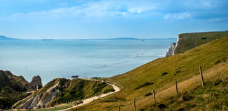 Coastal Path on the Top of Cliffs. Coastal path leading down to Durdle Door, part of the beautiful Jurassic coast, in the South of England Royalty Free Stock Photography