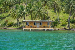 Coastal property with tropical house over water Stock Image