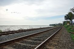 Coastal railway tracks along the ocean stock image