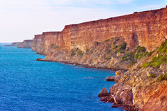 Coastal red rocks and blue Sea Landscape Summer Traveling Royalty Free Stock Photos