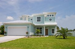Coastal residental 19. Bright pastel blue coastal living home in Florida Stock Image