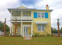 Coastal residential 3. Bright yellow coastal living home in florida Stock Photos