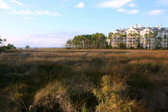 Coastal Resort. A coastal resort with marshland and water in the distance Stock Images