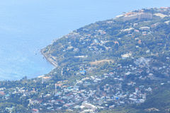 Coastal resorts of Crimea. Black sea. Aerial view from the top of Ai-Petri mountain. Hot sunny summer day. Beautiful perspective stock image