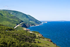 Coastal Road. Coastline showing Coastal Road and Tree Covered Hills on Sunny Day Royalty Free Stock Photos
