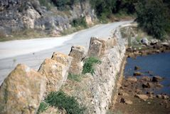 Coastal road. Stone columns along coastal, mountain road. Croatia stock photo
