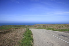 Coastal Road Cornwall England. Coastal Road and fields and sea in South Cornwall England Stock Photo