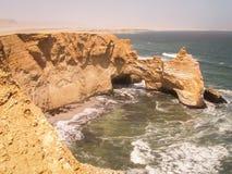 Coastal Rock Arch Ballestas. A natural rock arch off the coast of the Ballestas Islands, Peru Stock Photos