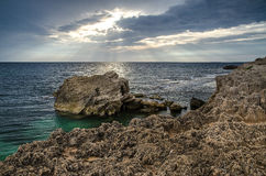 Coastal rock, Is Aruttas, Sardinia. Nicely illuminated sky with coastal rock at Is Aruttas beach, Sardinia stock photography