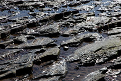 Coastal Rock Formations Seawater and Sand Royalty Free Stock Photography