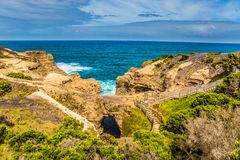 Coastal rocks of Australia. Great Ocean Road of Australia. Coastal rocks formed a picturesque arch of sandstone. The concept of exotic, active and photo-tourism stock photos