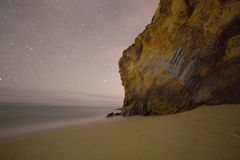 Coastal rocks in a dark with star trails Royalty Free Stock Photo