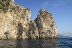 Coastal rocks at the Mediterranean Sea in Capri island Stock Images