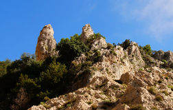 Coastal rocks at the Mediterranean Sea in Capri island Stock Photos