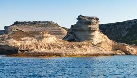 Coastal rocks of mountainous island Corsica Stock Photos