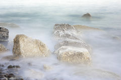 Coastal Rocks. Waves crashing on the rocks Royalty Free Stock Photos
