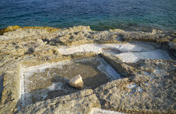 Coastal Salt Pans. Marsaskala, Malta. Historic old stone salt pans in Marsaskala coast, used for getting salt from sea water by evaporation, Malta Stock Photography