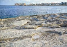 Coastal Salt Pans. Marsaskala, Malta. Historic old stone salt pans in Marsaskala coast, used for getting salt from sea water by evaporation, Malta Stock Photos