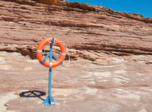 Coastal Sandstone and Life Ring Stock Image