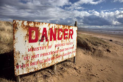 Coastal scene. With danger sign on beach royalty free stock image