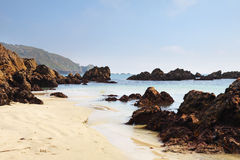 Coastal scene in Guernsey with sandy beach Royalty Free Stock Image
