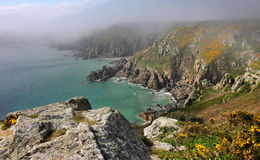 Coastal scene in Guernsey with sea mist Royalty Free Stock Images