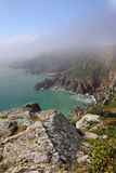 Coastal scene in Guernsey with sea mist Royalty Free Stock Photo