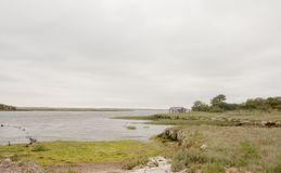 Coastal scene with overcast sky clear space and bay land rock an Royalty Free Stock Photography