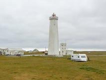 Coastal scenery with lighthouse Stock Images